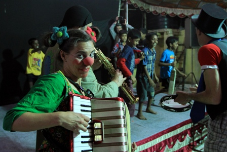 A performer plays the xylaphone in Mumbai on 3 March 2012.