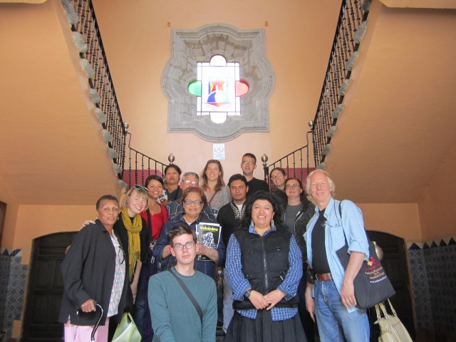 Delegation w/ Laura in front of symbol of Workers University